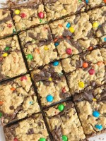 Monster Cookie Brownies   Monster Cookies   Brownies   Brookies   Monster cookie brownies start with a boxed brownie mix and then topped with a homemade monster cookie dough. Two desserts in one! Milk chocolate brownies and monster cookies loaded with peanut butter, oats, chocolate chips, and m&m's. #dessert #easydessertrecipes #brownies