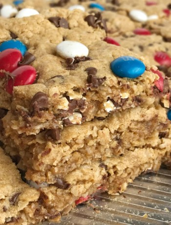 No Flour Red, White, & Blue Cookie Bars | No Flour Desserts | Gluten Free | Cookie Bars | Monster Cookies | Celebrate Memorial Day and 4of of July with these fun and festive no flour red, white, & blue cookie bars. Cookie bars with no flour and loaded with peanut butter, oats, chocolate chips, and m&m's. This holiday dessert recipe will be the hit of the BBQ. Makes an entire cookie sheet so there is plenty to serve a crowd. #glutenfree #4thofjuly #patriotic #easydessertrecipes