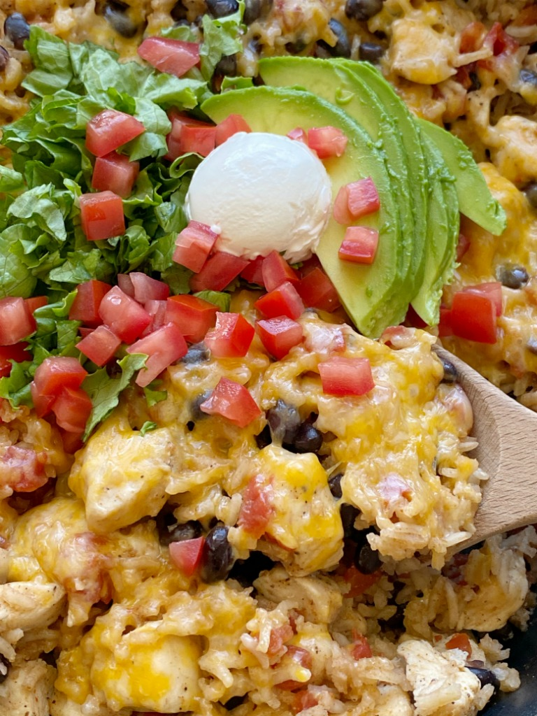 Chicken Burrito Skillet is a one pan easy dinner recipe that's made right on the stove top in 30 minutes. Chunks of chicken, rice, beans, and tomatoes simmer in seasoned chicken broth.