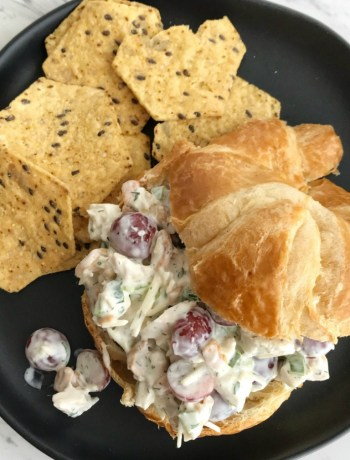 Parmesan Chicken Salad | Chicken Salad Recipe | Chicken | This classic, creamy, and easy to make chicken salad recipe is a go to for hot summer days. Chunks of chicken, cashews, red grapes, parmesan cheese, green onions in an easy homemade buttermilk ranch dressing. Serve with croissant and rolls for an oven-free dinner. #dinner #dinnerrecipes #chicken #chickensalad