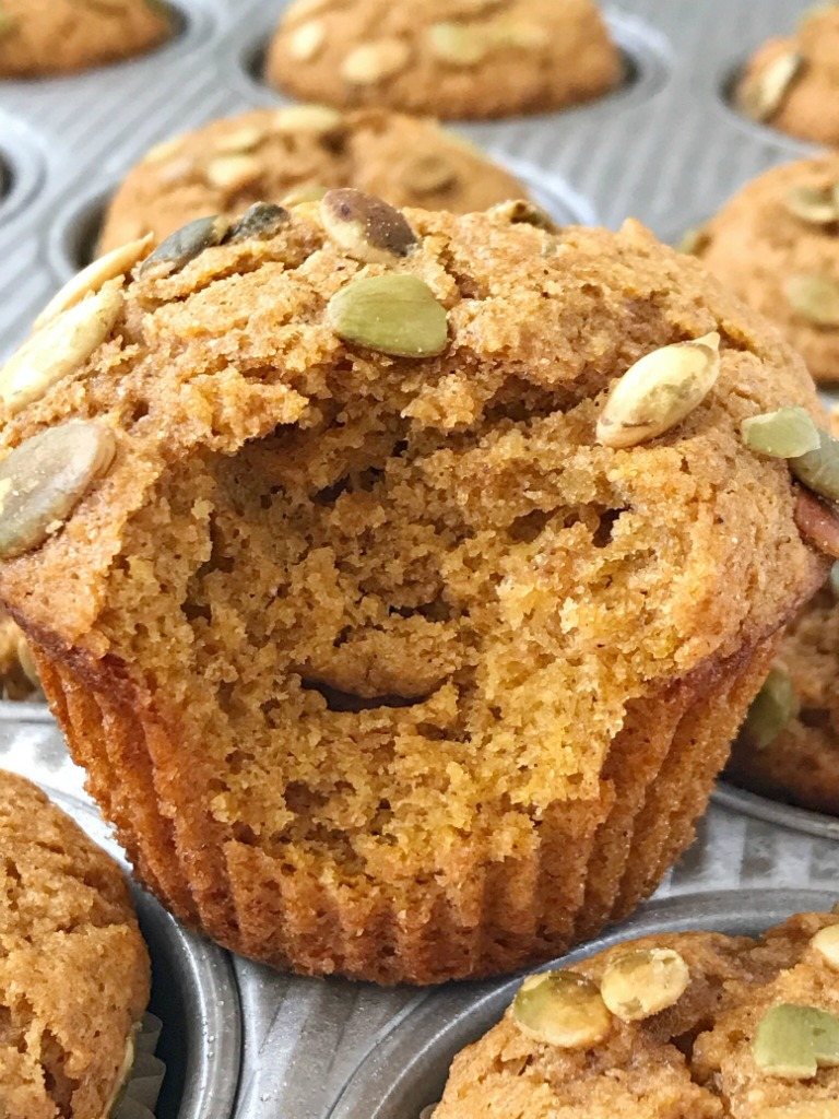Honey Wheat Pumpkin Muffins | Pumpkin Muffin Recipe | Pumpkin Recipe | Healthy honey wheat pumpkin muffins have no white flour or white sugar and are only one bowl! Made with honey, whole wheat flour, brown sugar, pumpkin, and warm pumpkin spice. Top with some pepitas for the best pumpkin muffin recipe. #pumpkin #pumpkinrecipes #muffins #pumpkinmuffins #fallrecipe