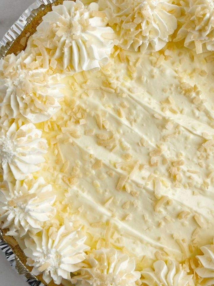Coconut cream pie recipe with instant pudding mix and cream cheese and toasted coconut on top.