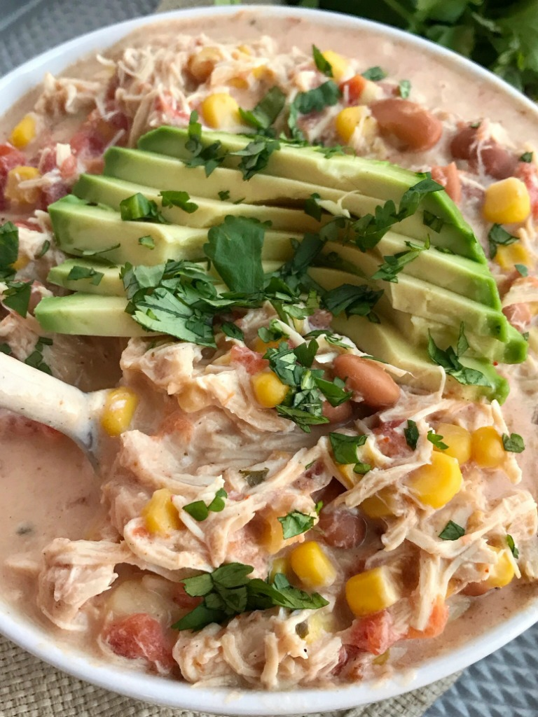 Creamy Southwest Chicken Chili | Slow Cooker | Crock Pot Chili | Chili Recipe | White Chicken Chili | Creamy chicken chili with southwest flavors that cooks right in the crock pot. Chicken breast, corn, pinto beans, ranch seasoning & spices combine in the slow cooker for an easy, simple family dinner. Serve with shredded cheese, avocado slices, and cilantro. #chili #chilirecipes #dinnerrecipe #chicken #slowcookerrecipes