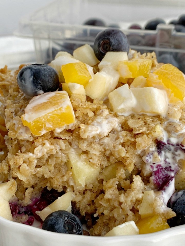 Fruity Baked Oatmeal | Baked Oatmeal | Breakfast Recipe | Baked oatmeal with quick oats, fresh blueberries, peaches, and diced apple. Sweetened with brown sugar and contains 3 entire cups of oatmeal. Warm, comforting and can be eaten for breakfast or a snack. #breakfast #breakfastrecipe #recipeoftheday #oatmeal #bakedoatmeal