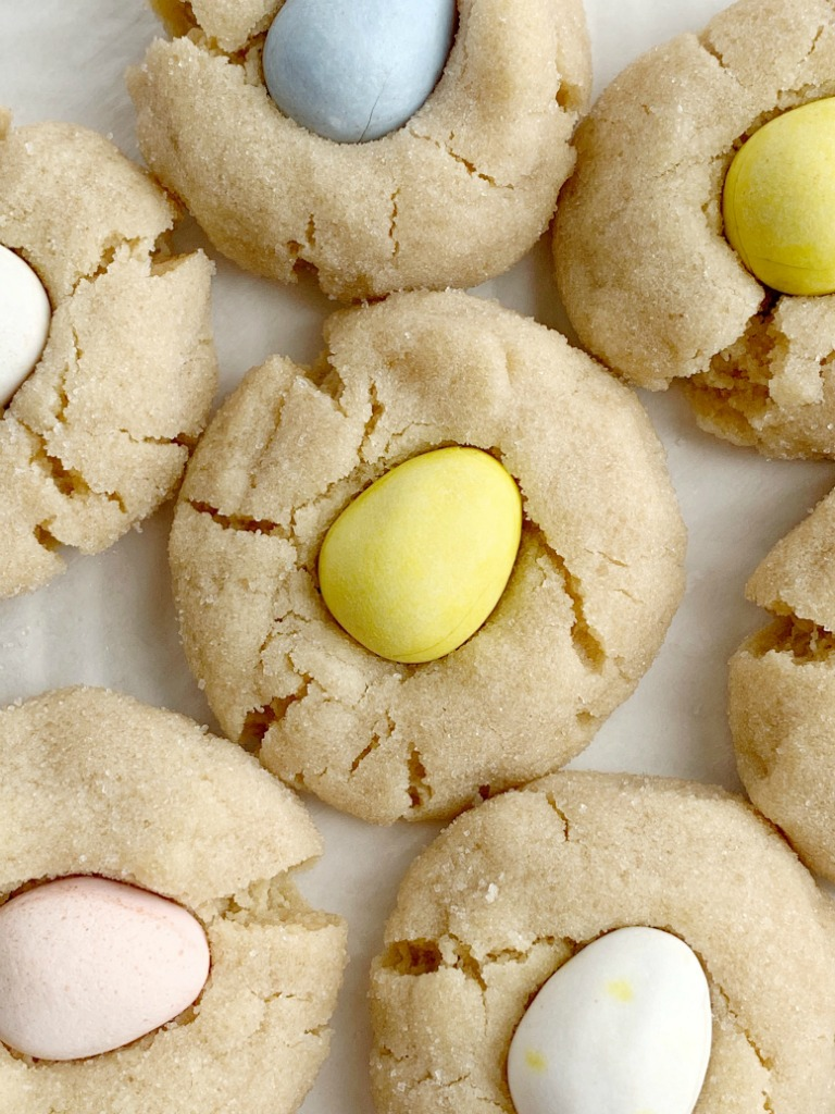 Cadbury Egg Kiss Cookies   Kiss Cookies   Cadbury Mini Eggs   Easter Recipe   Cadbury Egg Kiss Cookies are a fun way to celebrate spring and Easter! Soft, thick peanut butter cookies rolled in sugar and topped with a Cadbury Mini Egg. #easter #easterrecipes #cadburyminieggs #kisscookies #cookies #peanutbutter #dessert #recipeoftheday