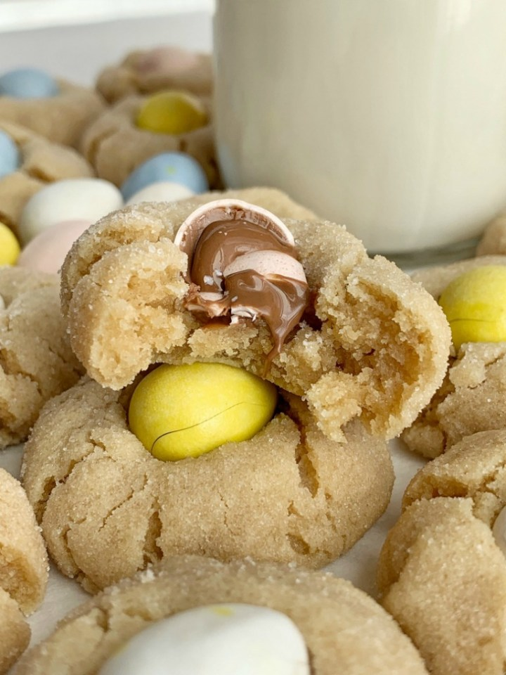 Cadbury Egg Kiss Cookies | Kiss Cookies | Cadbury Mini Eggs | Easter Recipe | Cadbury Egg Kiss Cookies are a fun way to celebrate spring and Easter! Soft, thick peanut butter cookies rolled in sugar and topped with a Cadbury Mini Egg. #easter #easterrecipes #cadburyminieggs #kisscookies #cookies #peanutbutter #dessert #recipeoftheday