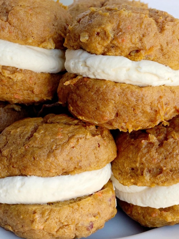 Carrot Cake Cheesecake Whoopie Pies | Whoopie Pies | Carrot Cake | Soft-baked, cake mix carrot cookies with a light and fluffy cheesecake cream filling. Carrot Cake Cheesecake Whoopie Pies are the best of both worlds. Carrot cake + whoopie pie! #carrotcake #cheesecakerecipes #carrotcakerecipes #easterrecipe #recipeoftheday #dessertideas #dessertrecipes