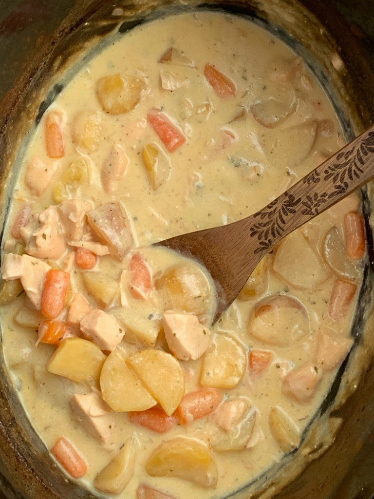 Crock Pot Creamy Chicken Stew   Chicken Stew   Stew Recipes   Slow Cooker Recipes   Chicken Stew made right in the slow cooker! So simple to make, creamy, delicious, comfort food, that the entire family will devour. Carrots, potatoes, and chunked chicken is cooked in a creamy sauce with ranch seasoning, chicken broth, cream of chicken soup, and sour cream in the crock pot. #stewrecipe #recipeoftheday #dinnerideas #slowcooker #crockpot #chickenrecipes