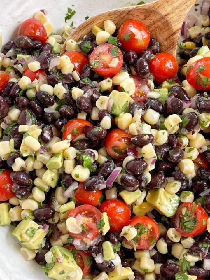 Avocado salad inside a white serving bowl.