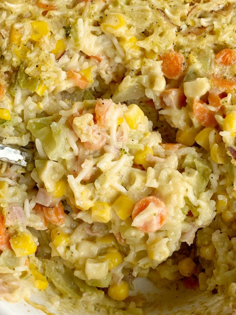 Ham & Broccoli Rice Casserole | Casserole Recipes | Casserole | Dinner Recipes | Broccoli Rice Casserole is loaded with flavorful rice, carrots, corn, chopped ham, and cheese. This rice casserole is a great way to use up leftover ham, bakes up in one pan, and it's a family favorite. #casserole #dinnerrecipes #dinner #recipeoftheday