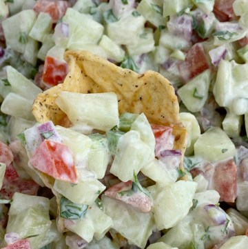 Cucumber Salsa | Healthy Recipe | Salsa Recipes | Cucumber salsa is full of fresh cucumber, tomatoes, cilantro, red onion, jalapeño, and a light & creamy seasoned dressing. Serve with chips, as a side dish, or on top of grilled meat for a deliciously light summertime recipe. #appetizerrecipes #salsas #dips #recipeoftheday #healthyrecipes #summerrecipes