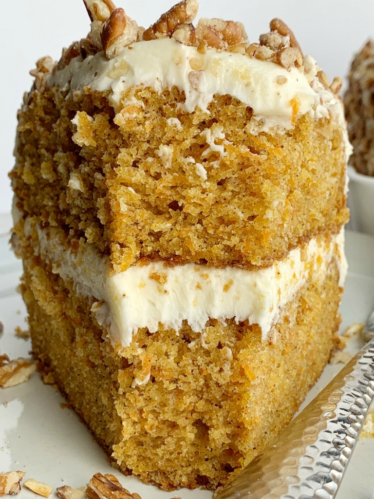 The Best Carrot Cake | Carrot Cake Recipe | Easter Recipes | The best carrot cake recipe has layers of moist & flavorful carrot cake topped with a  luscious whipped cream cheese frosting, and chopped pecans. No extra stuff inside the cake, just shredded carrots! #cake #cakerecipes #dessert #dessertrecipes #carrotcake #easterrecipes #recipeoftheday