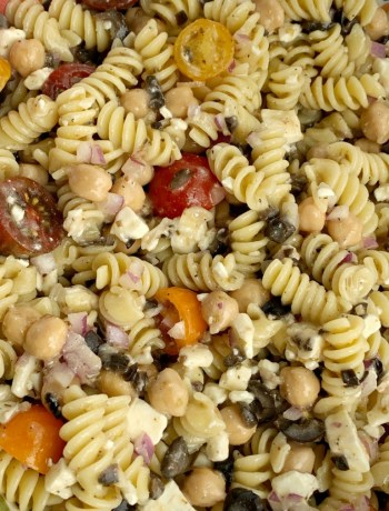 Greek Pasta Salad | Pasta Salad Recipes | Easy Greek Pasta Salad with tender spiral pasta, feta cheese, black olives, cherry tomatoes, red onion, and chickpeas with a easy dressing of Greek Vinaigrette salad dressing. So much flavor and texture, it's sure to be a hit. #salad #pastasalads #greek #sidedish #summerrecipes #pastasaladrecipes #recipeoftheday