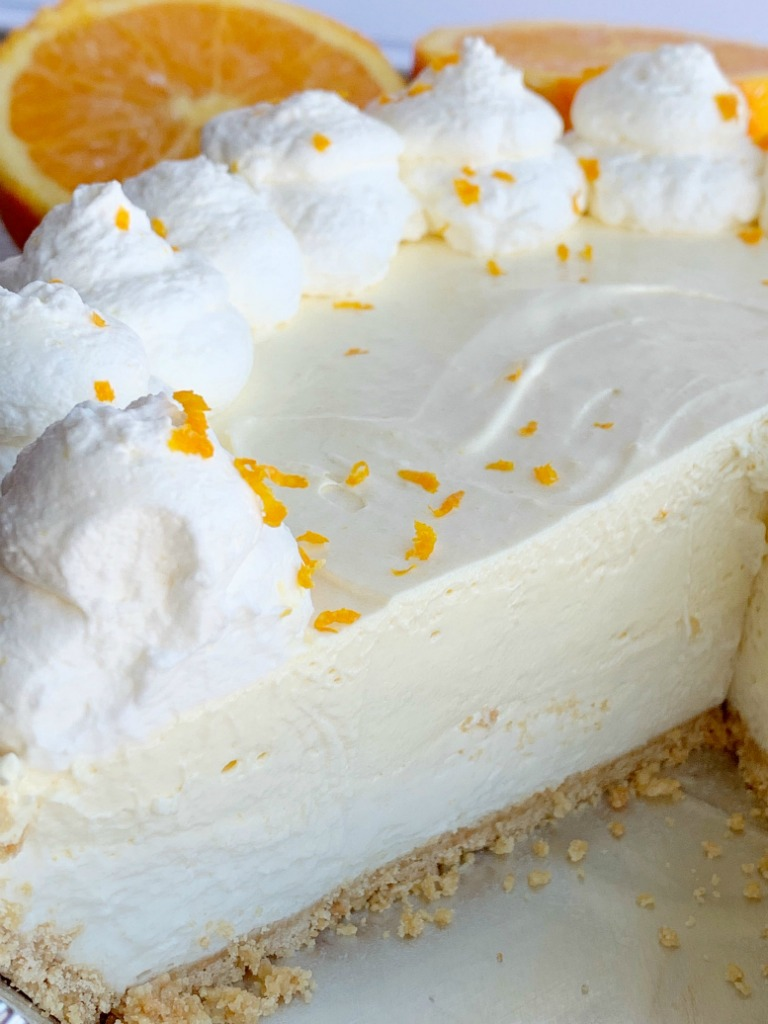 No Bake Orange Creamsicle Pie | No Bake Dessert | Pie | Orange Creamsicle Pie is a no bake dessert that is so refreshing and full of sweet orange cream flavor. Made easy with a prepared graham cracker crust, a sweet cream layer, and a light & fluffy orange layer with fresh orange juice and orange zest. #nobake #nobakepies #dessertrecipe #pies #summerrecipe #orangecreamsicle #easyrecipe #recipeoftheday