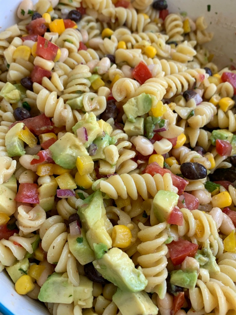 Cowboy Caviar Pasta Salad | Pasta Salad Recipe | Cowboy Caviar | Everyone's favorite Cowboy Caviar dip made into an easy Pasta Salad. Tender spiral pasta noodles, corn, sweet bell peppers, diced tomatoes, red onion, cilantro, avocado covered in Italian dressing and seasonings. #pastasalads #sidedishrecipe #cowboycaviar #summerrecipes #recipeoftheday #pastasaladrecipe