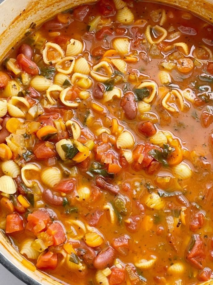 Minestrone soup recipe that cooks in one pot on the stove top with beans, vegetables, in a vegetable broth tomato sauce base.
