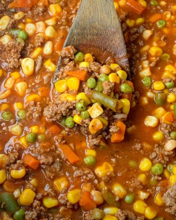 Vegetable Beef Soup only needs one pot and 30 minutes on the stove. Ground beef, frozen vegetables, tomato sauce, beef broth, and a couple surprise ingredients make this vegetable beef soup so delicious & easy to make!