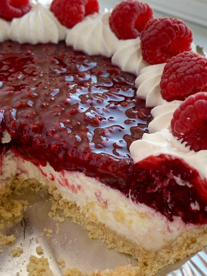 Raspberry Cream Pie has a sweet, cheesecake layer topped by a fresh raspberry layer inside an easy and convenient store-bought graham cracker crust!