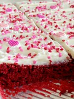 Easy Red Velvet Sheet Cake is so simple to make! A doctored up red velvet cake mix topped with the best, and fluffiest white chocolate cream cheese frosting.