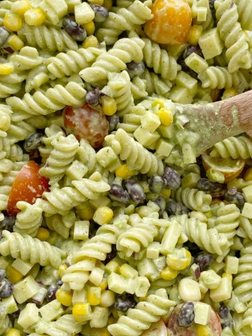 Pasta Salads | Pasta Salad Recipe | Cafe Rio Dressing Pasta Salad | Creamy Cilantro Ranch Pasta Salad is filled with spiral pasta noodles, black beans, corn, red onion, cherry tomatoes, and cubes of cheese with a super creamy (and yummy!) homemade cilantro ranch dressing. #pastasalads #ranch #saladrecipes