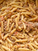 Creamy Tomato Beef Pasta is a 30 minute dinner recipe that the entire family will love! Pasta noodles covered in a creamy tomato ground beef meat sauce. Simple and easy to make.