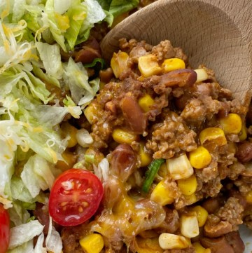 Taco Casserole is so quick & easy to make! No chopping required and it uses easy & convenient canned ingredients, ground beef, and fresh taco toppings.