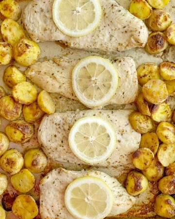 Lemon Chicken and Potatoes is a one sheet pan dinner recipe with crispy, soft lemon parmesan potatoes and juicy lemon garlic chicken breasts.