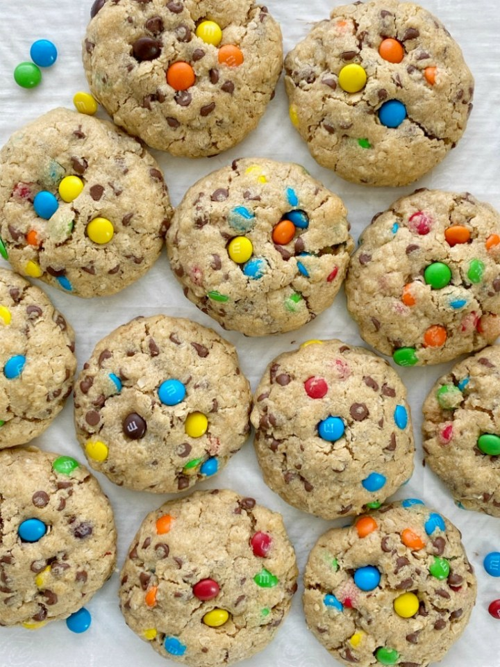 Reese's Stuffed Monster Cookies are monster cookies loaded with oats, peanut butter, chocolate chips, m&m's and stuffed with a Reese's miniature in the center! So soft, thick, chewy, and just the best cookie ever.