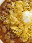 Crockpot Chili is sweet & spicy and so good served with sour cream, cheese, and Fritos. Made with three different beans, ground beef, tomato sauce, beef broth, seasonings, and my favorite chili ingredient ... cocoa powder!