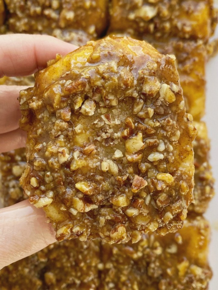 Easy Overnight Pumpkin Spice Sticky Buns are so quick & simple to make thanks to frozen bread rolls. Make them the night before and let it rise all night. Bake up a pan of caramel-y, gooey, pumpkin spice sticky buns with a pecan topping in the morning for a delicious breakfast treat.