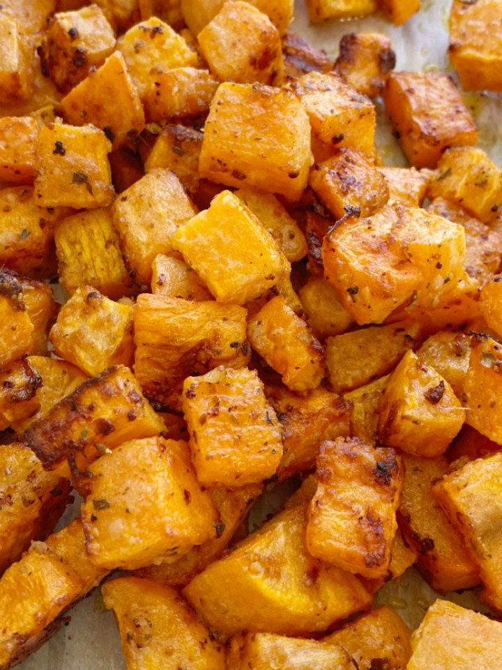 Roasted Garlic Parmesan Sweet Potatoes are roasted in butter, olive oil, parmesan cheese, and seasonings. A crispy charred outside with a soft sweet potato center. One bowl and a few simple ingredients are all you need for this delicious side dish recipe.