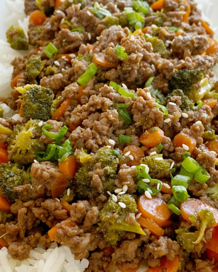 Ground Beef Teriyaki is an easy ground beef dinner recipe that simmers in a homemade teriyaki sauce, broccoli, and carrots. Serve over rice for delicious teriyaki rice bowls.