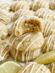 Stack of key lime pie cookies with a lime wedge.