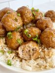Ground turkey meatballs topped with teriyaki sauce and green onions.