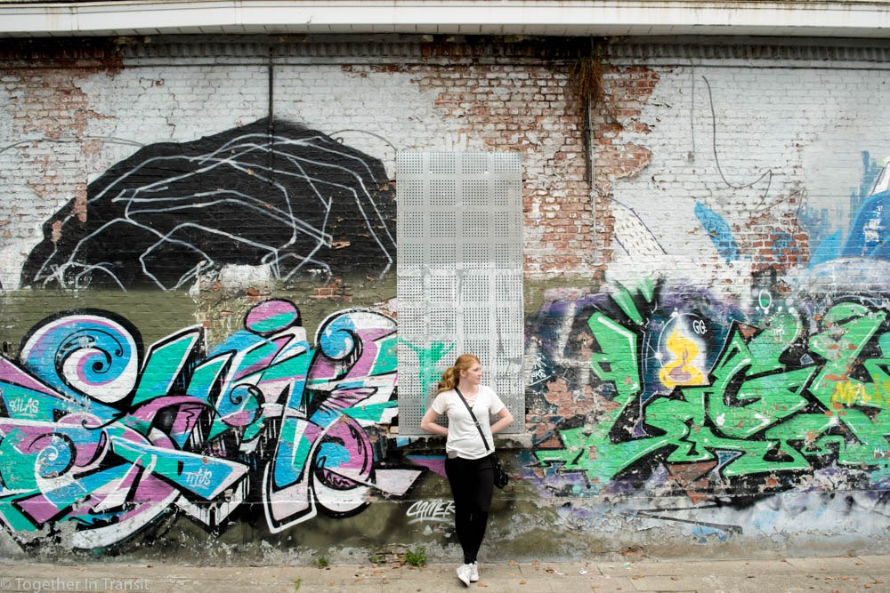 Standing next to some of the graffiti in Doel, the abandoned city in Belgium