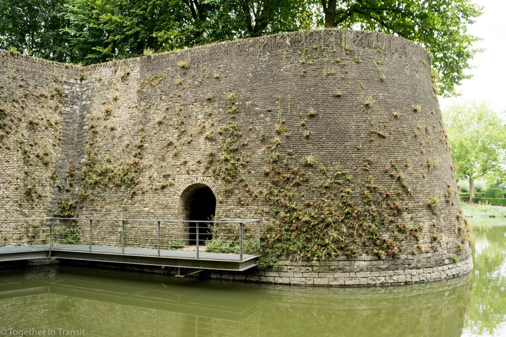 A section of the fortified wall of Ypres with the moat surrounding the city.