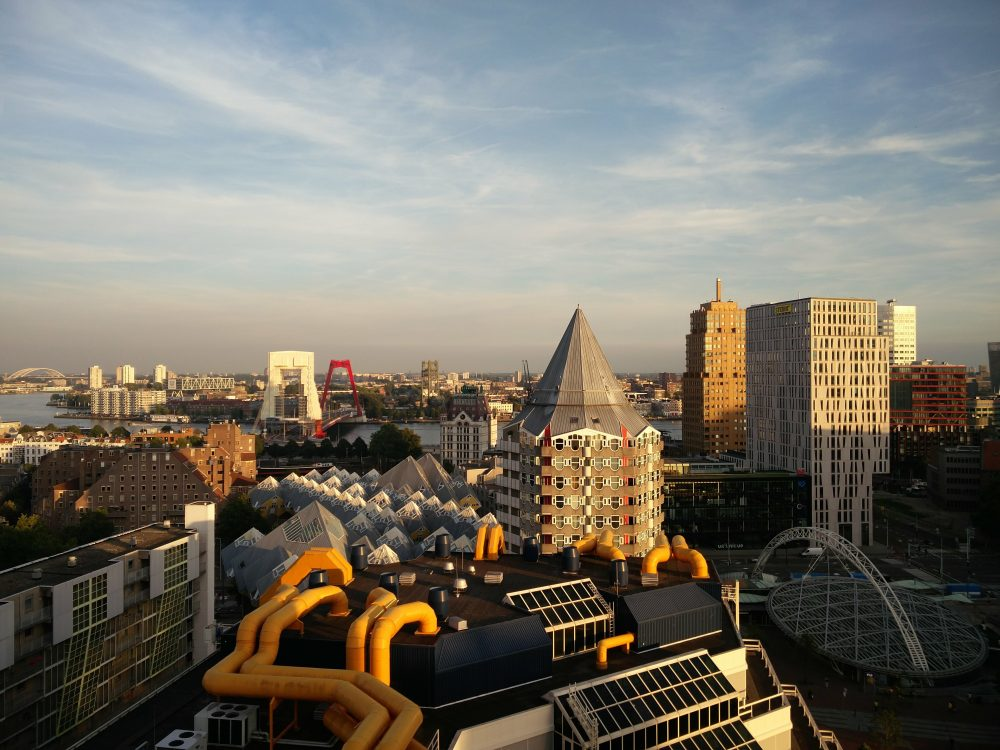Weekend Getaway Ideas In The Netherlands - The modern city of Rotterdam, Netherlands during the sunset.