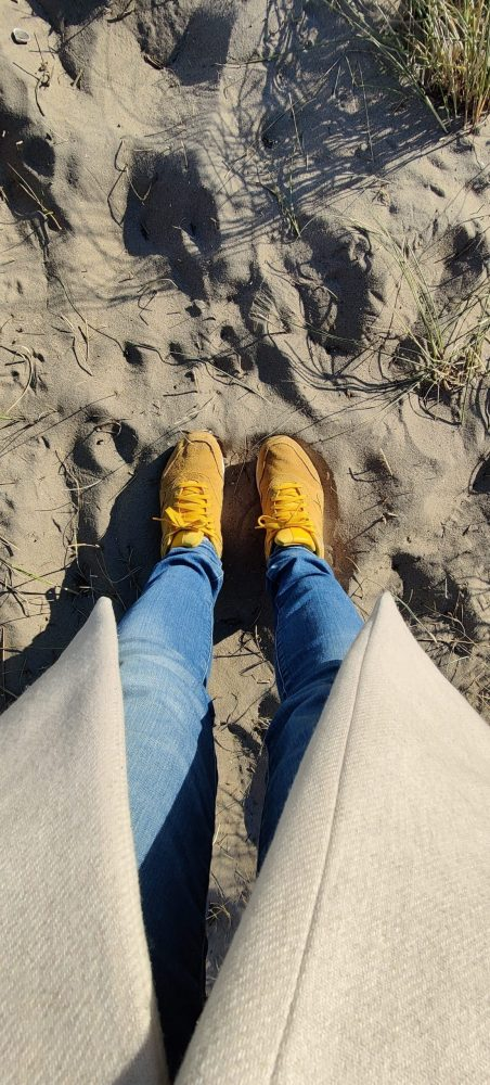 Yellow shoes on the yellow sand on the bach