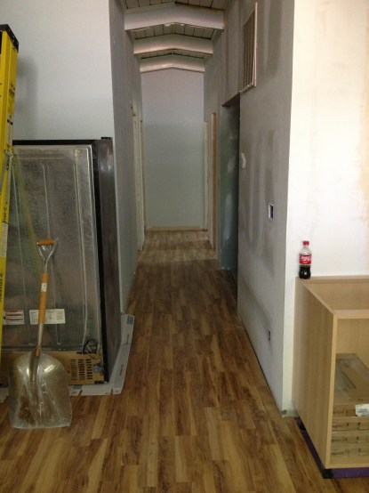 the hallway leading to the laundry, bathroom and bedrooms