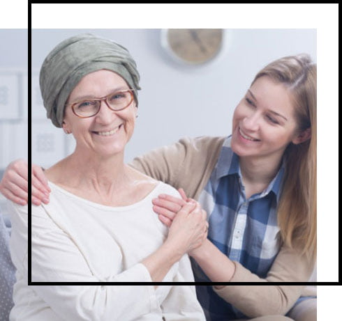 smiling elderly and young woman