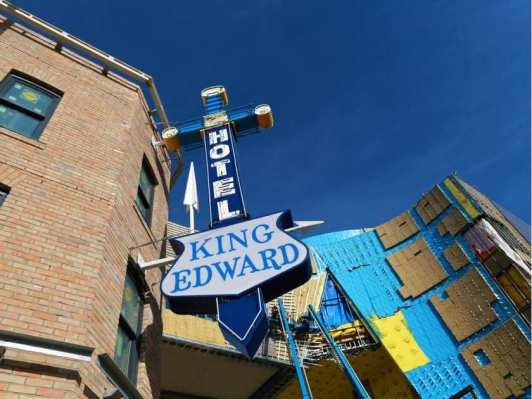 An example of engagement at work: looking up at the restored King Eddy Hotel sign in the newly dubbed Music Mile district in Calgary.