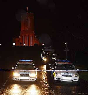 From PressPhotosUK.com.  30 November 2008.  Police guard the scene of a Police shooting at Guildford Cathedral tonight