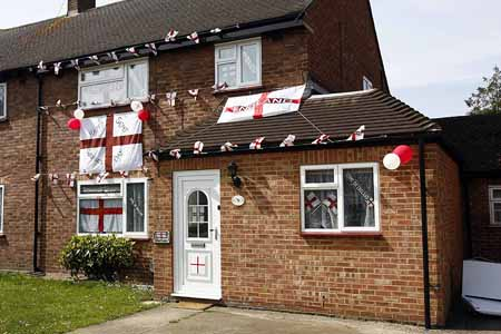 Georges Day Celebrations in Guildford.  House festooned with the Flags of St George and St George Cross Bunting in Bellfields Guildford.