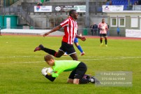 22/10/2016. Guildford City v North Greenford United. City's Mario EMBALA Is beaten to the ball by the keeper