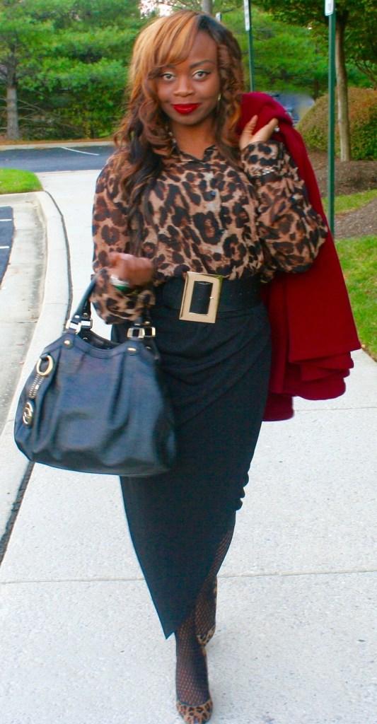 Animal print top, black wrap skirt, Gucci bag