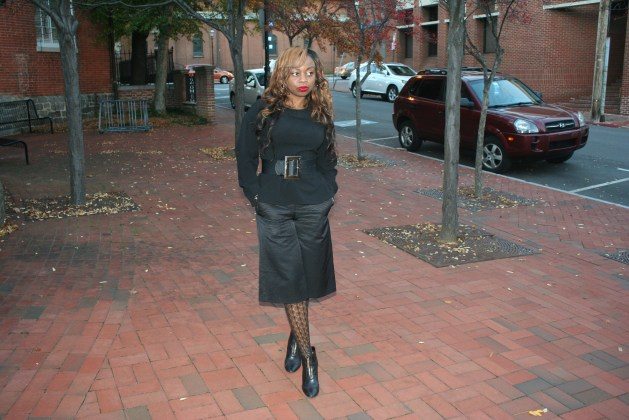 Black peplum top with bow, black culottes and black boots