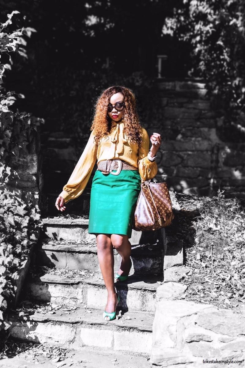 Mustard yellow top Green skirt Louis Vuitton bag
