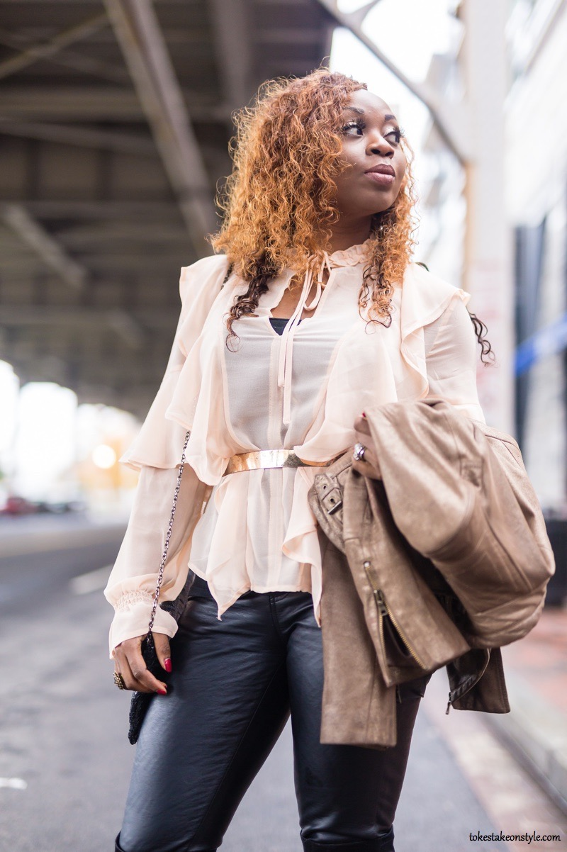 Fashion blogger wearing a blush top and leather pants