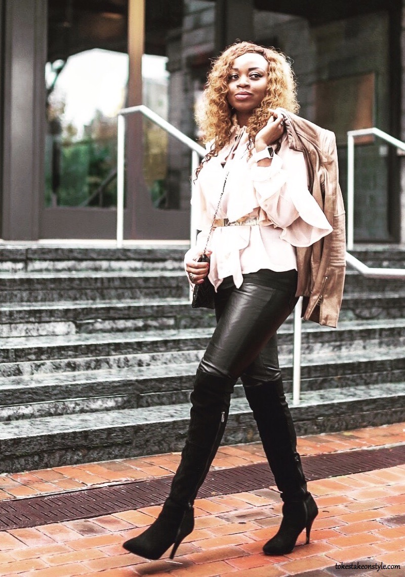 Fashion blogger in leather pants and otk boots