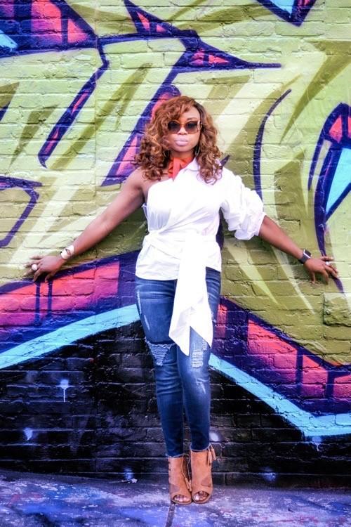 Blogger in asymmetrical top, Graffiti Alley, Baltimore, MD